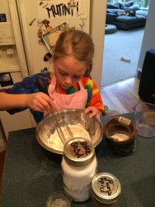 Anastacia mixing dry ingredients.